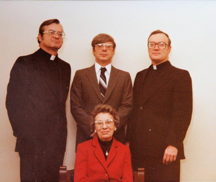 Paulist Fr. John Kenny with his family around 1986: His mother, Catherine Hurley Kenny, seated at front.  Behind her, left to right, are Paulist Fr. John Kenny; his brother, Thomas Kenny; and his brother, Fr. Jack Kenny (who had been priest of the Diocese of Joliet, IL).