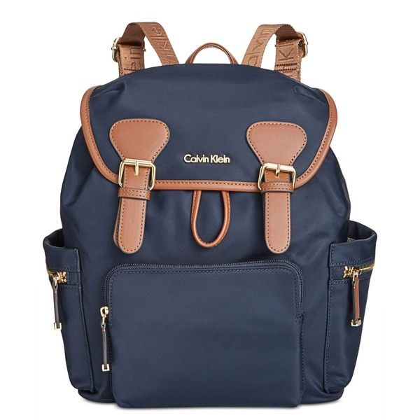 Calvin Klein Small Double Buckle Backpack ($141) ❤ liked on Polyvore featuring bags, backpacks, navy, calvin klein bags, navy blue backpack, navy blue bag, nylon bag and daypack bag