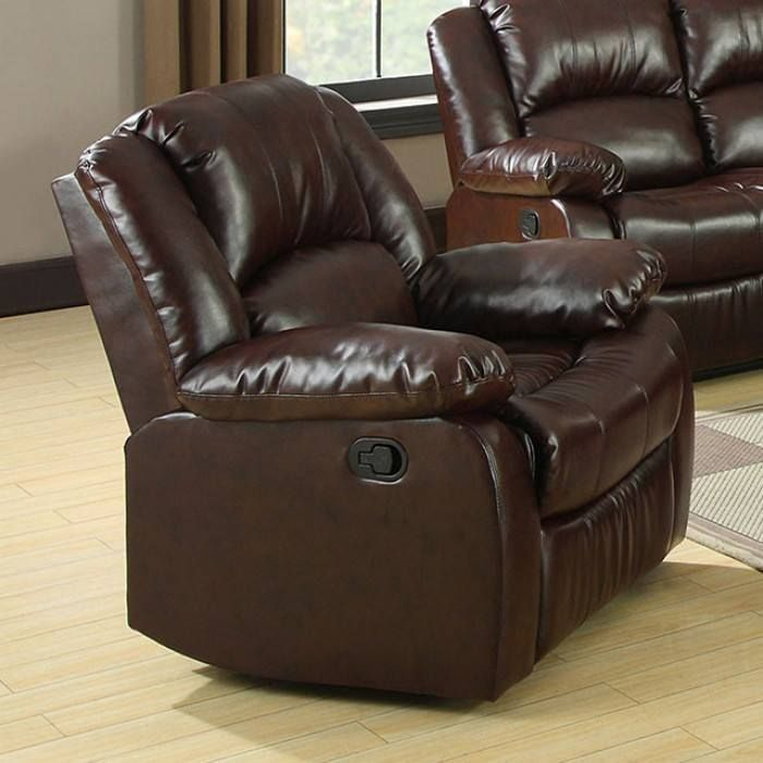 Relax and enjoy the soft comfort of this living room group, which includes built-in recliners in the sofa and love seat. Create a sectional by adding a corner chair. Upholstered in a rustic brown bonded leather. #JMDFurniture #LivingRoom #Recliner