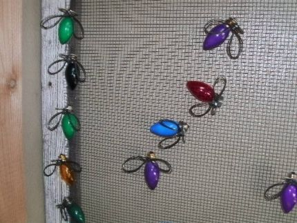 Bugs made from Christmas tree bulbs.  Maybe add some of them to my $1.oo Store Plate Flowers ??