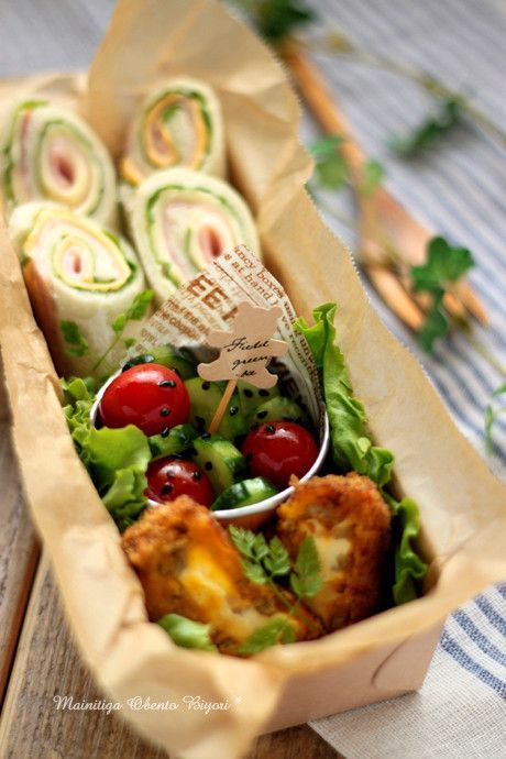 Rolled ham, cheese, & lettuce sandwich bento box, with sides of cream cheese & kabocha korokke (croquettes), and black sesame cherry tomato & cucumber salad