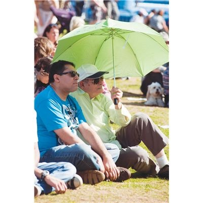 Man with umbrella . A traditional scene at Rotherham's annual show . . . but this time it's to keep the sun off!