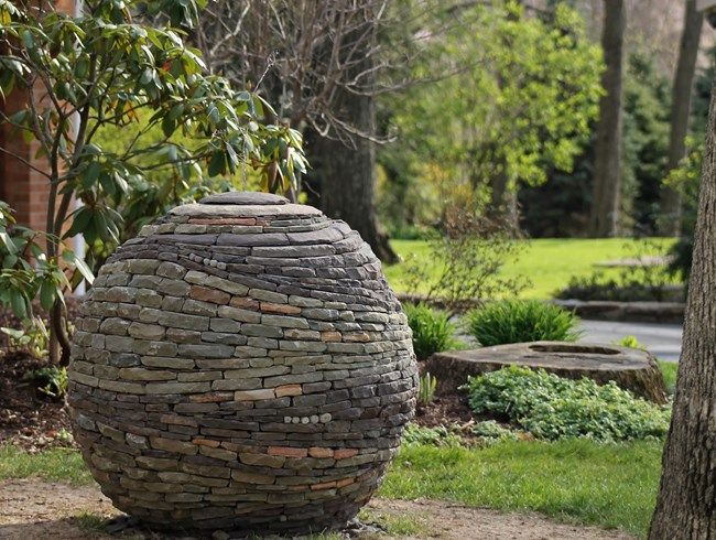 U201cA Ball Of Living Energy, Made From Multiple Colors Of Stone Swirling  About,u201d Is How Devin Devine Describes His Latest Garden Art Creation