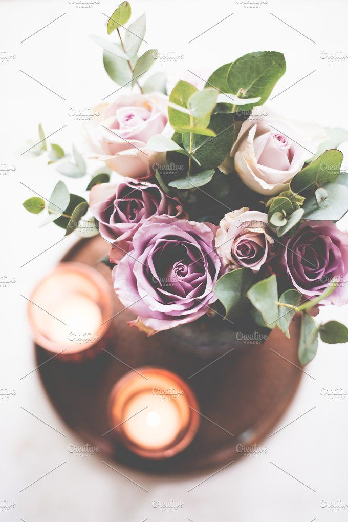 purple, mauve color fresh summer roses in vase with white wall b by Fancy Things