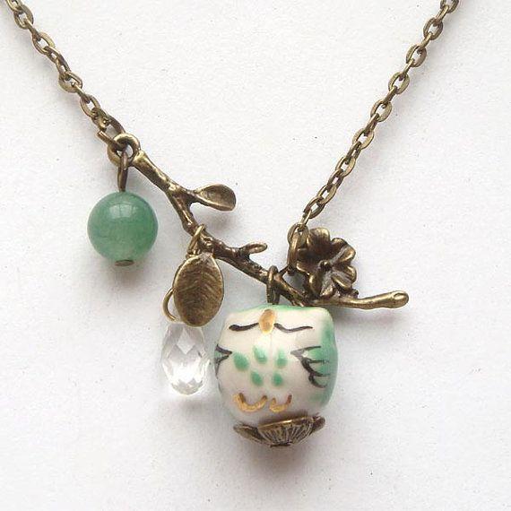40mm antique brass leaf pendant, 8mm green jade round bead, quartz teardrop bead, 16mm porcelain owl pendant, antiqued brass chain.