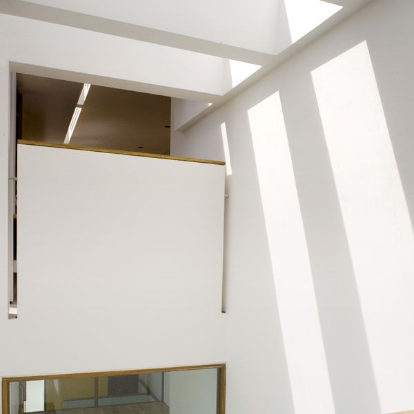 Moving the entrance also maximised the space available and created a double height, top lit space with the circulation behind a wall concealing how one moves from the differing levels.