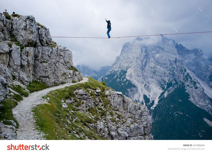 """Monte Piana, Dolomites/Italy - September 08, 2013: An Acrobat On A Rope Tended Above An Abyss During """"Highline Meeting"""" Of Tightrope Walkers From Around The World Taking Place Every Year On September Stock Photo 321906044 : Shutterstock"""