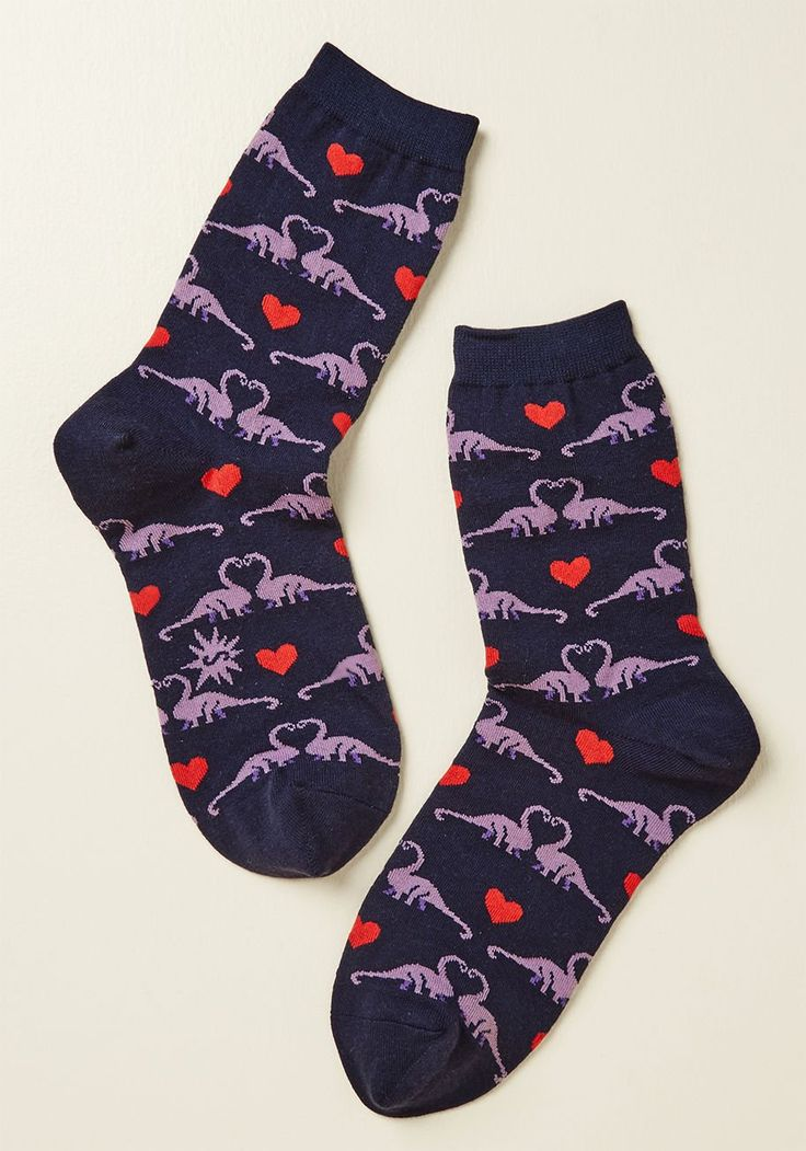 Ancient Arrangement Socks - Adoration has existed for as long as time, and the purple Brachiosaurus nuzzling on these navy blue socks are proof that love is still alive! Accented with red hearts and made from a comfy knit, these cute crews will have you wanting to canoodle, too.