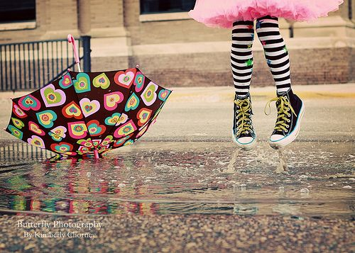 """ some people walk under the rain ..some others dance along with it! """