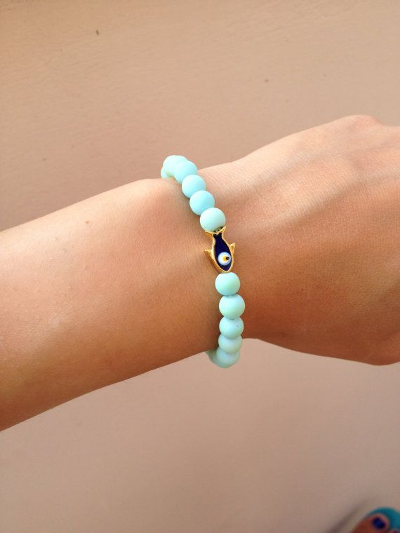Bracelet with blue rubber covered beads and gold by HappyDonkey, €5.00