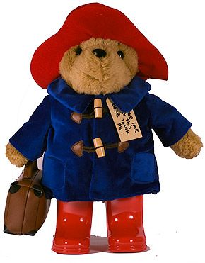 Paddington Bear. I bought my little Paddington Bear when I was in London in 2008....what better keepsake could a bear lover purchase across the pond!! Mine looks like this one, except toggles on coat of mine are leather like sewn on tabs.
