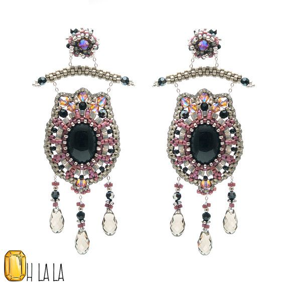 Black Onyx offset by pink and silver makes these gorgeous statement earrings so fashionable.  The colors complement each other perfectly. Sterling