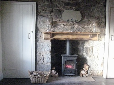 Inset in stone fireplace