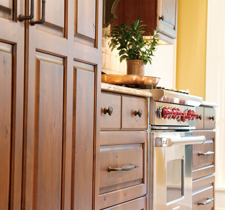 Cottage Kitchen Cabinets With Rich Stain Finish