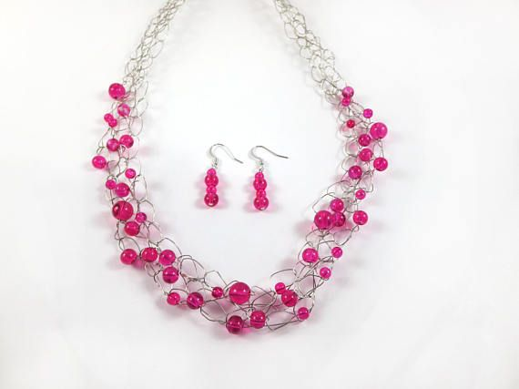 This pink statement necklace and earrings are the perfect accessory to add a touch of colour to any outfit! They complement casual, everyday outfits or can complete your formal look. Designed with the modern woman in mind, these pink earrings and necklace are both stylish and comfortable to wear.