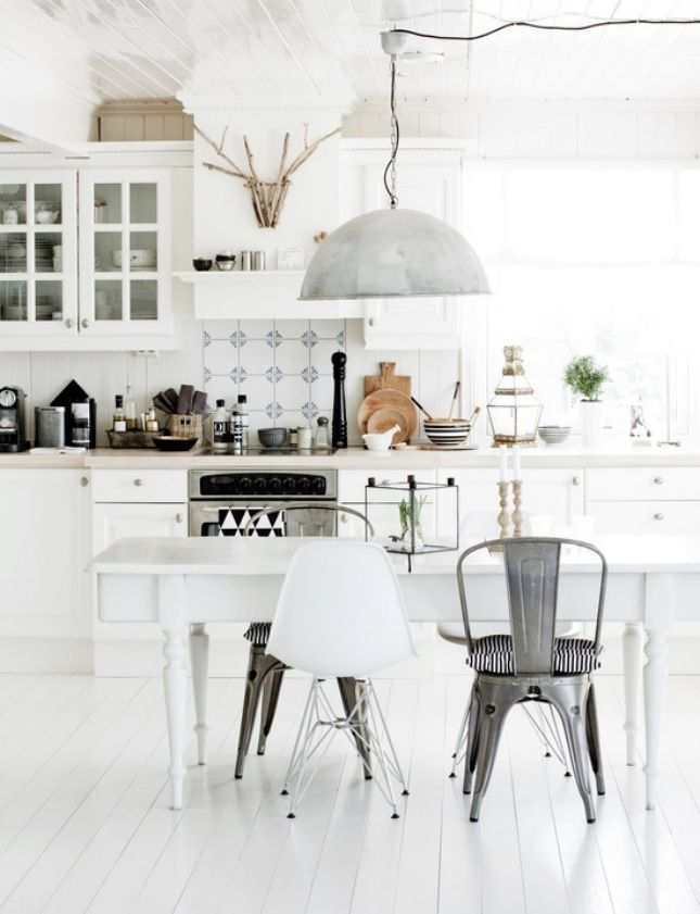 Give your kitchen floors an instant facelift by painting them white.