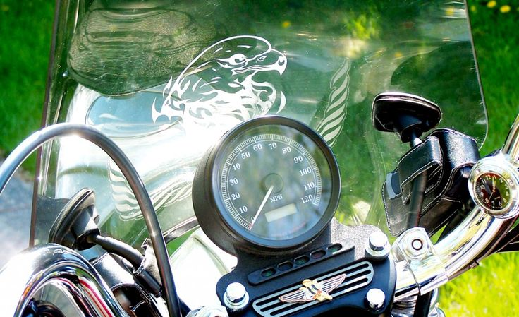 "Cindy had a little clock mounted so that she knows when to go home and make the transformation from biker chick back to mamaw (southern talk for grandmother). The case on the right holds her garage door opener and the tiny angel below the speedometer is a pin that was mounted. Cindy says, ""I call her my guardian angel. She keeps me safe."""