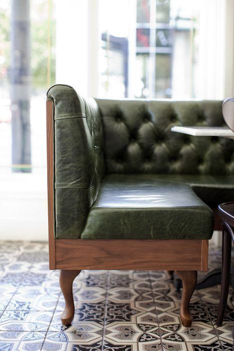 Gorgeous tile floor for kitchen.  Restaurant & Bar design awards. Green leather bench seating.