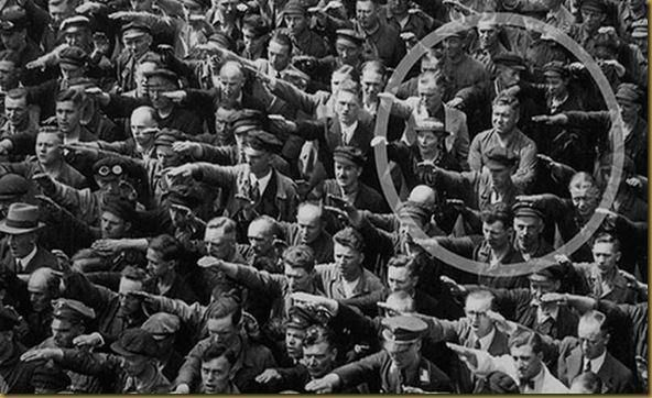 The photo was taken in Hamburg in 1936, during the celebrations for the launch of a ship. In the crowd, one person refuses to raise his arm to give the Nazi salute. The man was August Landmesser. He had already been in trouble with the authorities, having been sentenced to two years hard labour for marrying a Jewish woman.  Absolutely non repentant, August stands firm, arms crossed in defiance.: Brave German, Hard Labor, German Blood, Old Photographs, Jewish Woman
