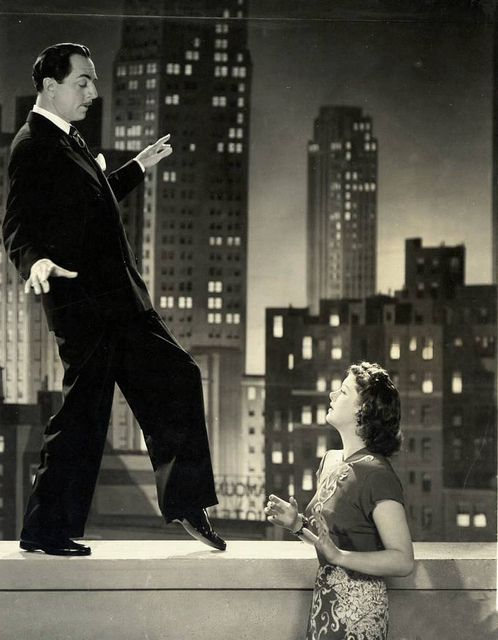 """William Powell and Myrna Loy as Nick and Nora Charles in """"The Thin Man"""" series of films."""
