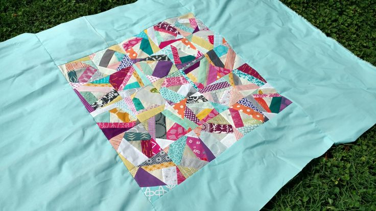 Scrappy modern paper pieced quilt using Kona solids as well.
