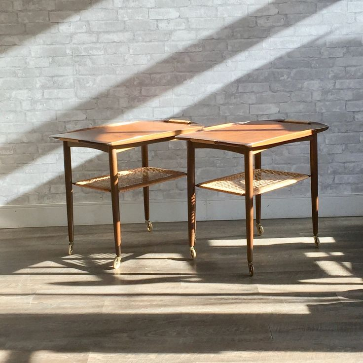 What do you think of this? Mid-Century Walnu.... You can check it out here:  http://vintagehomeboutique.ca/products/mid-century-walnut-rolling-bar-carts-or-tables-by-poul-jensen-for-selig?utm_campaign=social_autopilot&utm_source=pin&utm_medium=pin