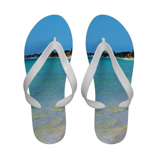 Beautiful Coastal Jamaica Beach Sand Flip-Flops This beautiful flip flop features landscape nature travel photography of the famous 7 mile beach taken in tropical Negril, Jamaica with black text and the waves, sand, beach in the background. Great for a summer loving warm weather beach lover.