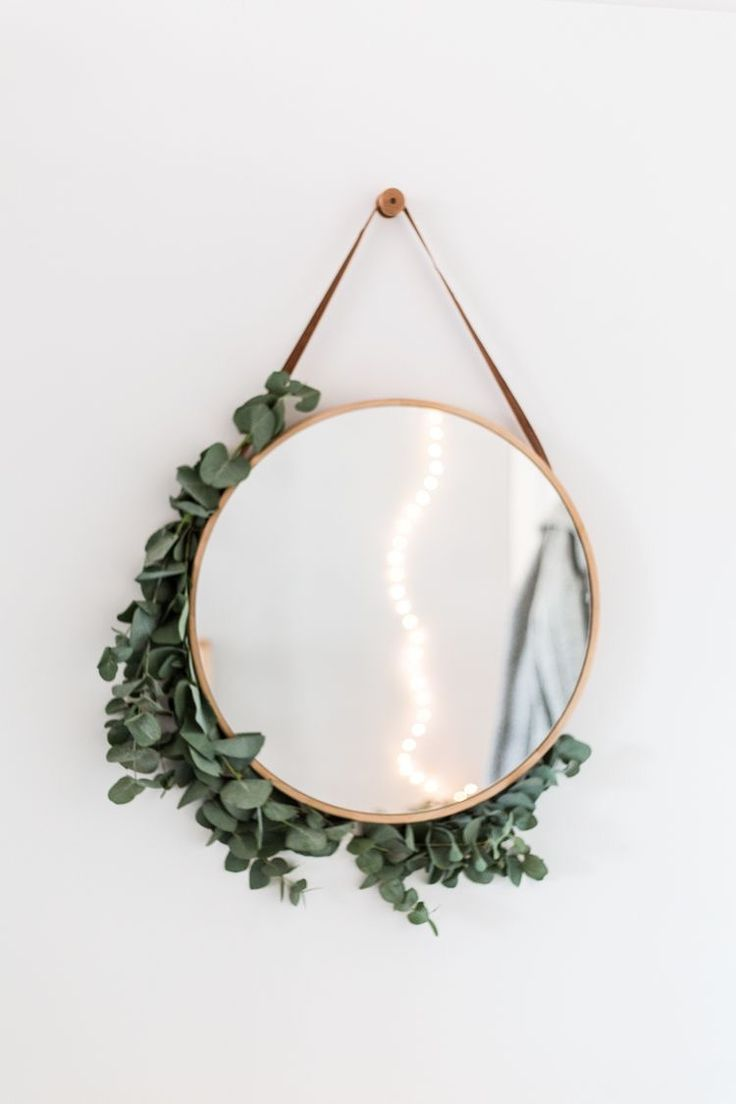 greenery around the mirror
