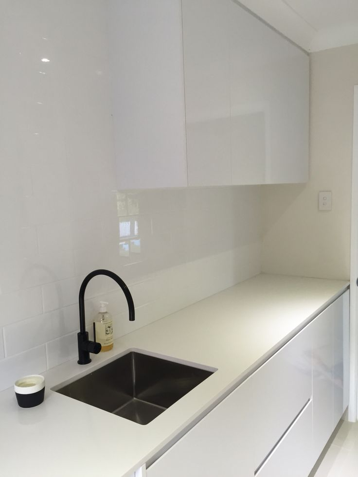 Modern Laundry + Under Mount Sink + Stone Bench top + Black Tap
