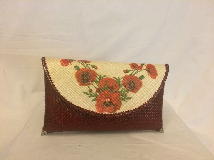 Small clutch bag with red flower