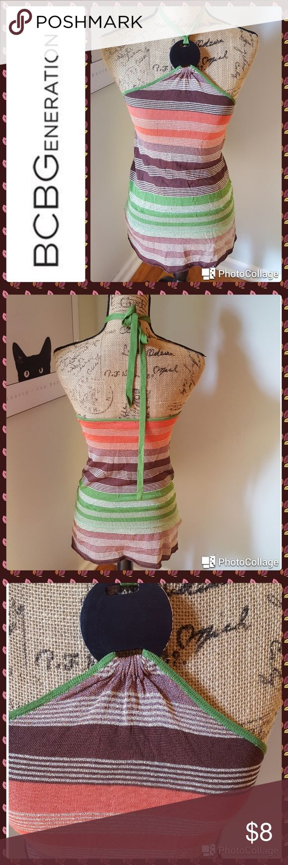 """🌞SUMMER SALE! NOTHING OVER $15! NO OFFERS! In great condition.  BCBGENERATION top. Orange, brown and green rayon blend halter style. Wooden disc on front. Bust 34"""", length 27"""". BCBGeneration Tops"""