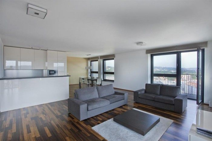 A luxurious, spacious four-bedroom apartment with panoramic views of Prague including the Vltava and Prague castle, set on the 15th floor of the tower in the award winning Holešovice brewery development.