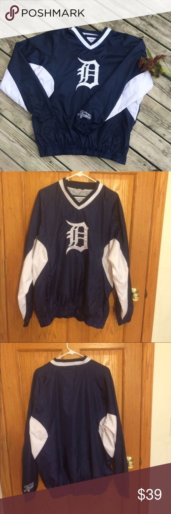"""Genuine Mechandise Detroit Tigers Windbreaker This is an authentic """"genuine merchandise"""" MLB Detroit Tigers Pullover windbreaker. Two front pockets and quarter zipper on the lower left side. 100% polyester. Excellent condition!! R3 Genuine Merchandise Jackets & Coats Windbreakers"""