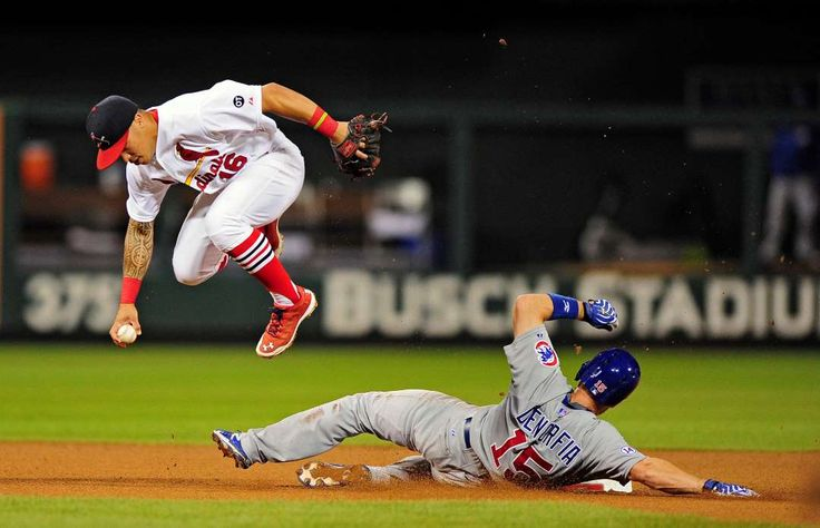 Avoiding spikes -        St. Louis Cardinals second baseman Kolten Wong (16) leaps over Chicago Cubs right fielder Chris Denorfia (15) after forcing him out during the seventh inning at Busch Stadium on Sunday in St. Louis. The Cardinals won 4-1.    -    © Jeff Curry/USA TODAY Sports