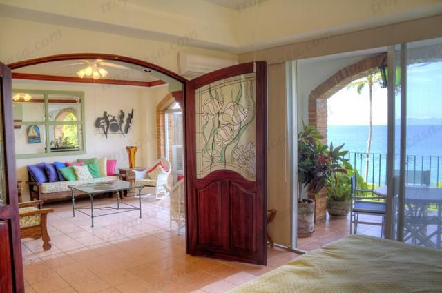 http://www.tropicasa.com/condos/Orquideas-16/555 - This beachfront condo will surprise you with tranquility, beautiful garden and ocean views. The living areas are all open and interact with each other. Great price!