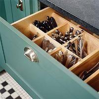 Teal cabinets, black granite countertops!