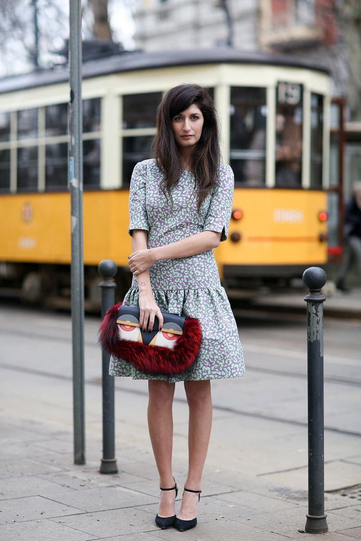 Valentina Siragusa and a chic Fendi clutch. #MFW #Streetstyle