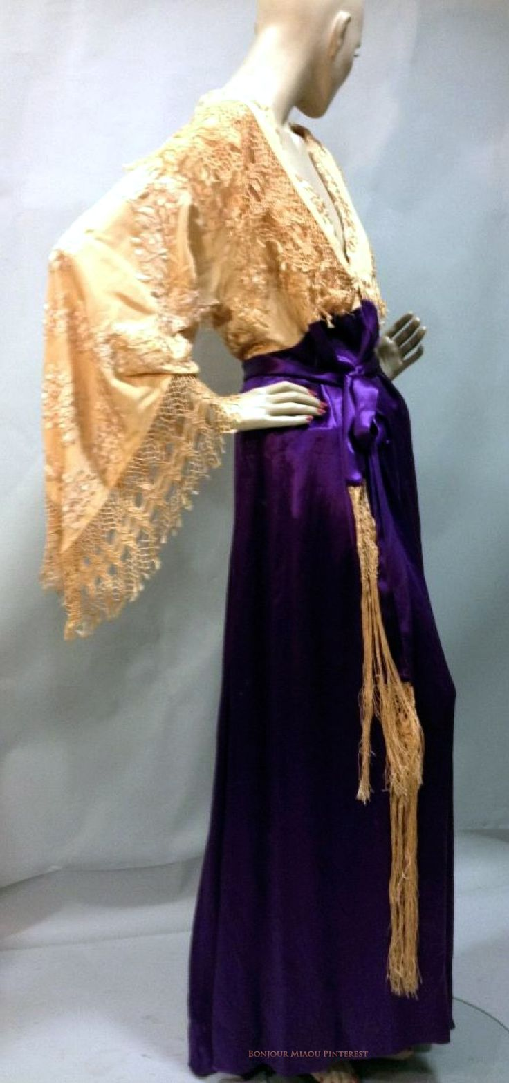 Robe d'interieur ca. 1910. Remarkably soft & unconstructed. Violet satin skirt flows from high waist, bodice with pagoda sleeves, long fringe of salmon-colored silk. Thierry de Maigret Auctions