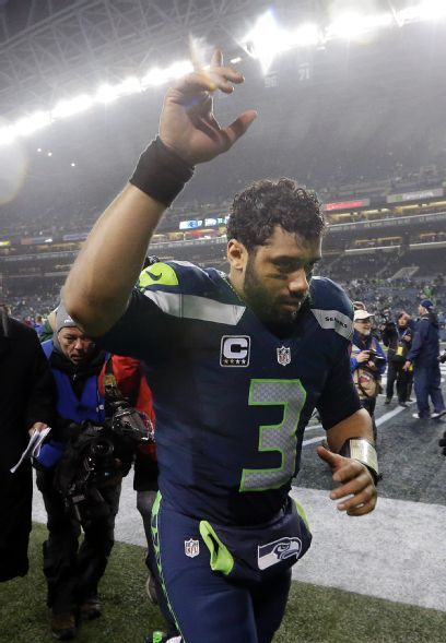 Seattle Seahawks quarterback Russell Wilson (3) runs off the field after an NFL divisional playoff football game against the Carolina Panthers in Seattle, Saturday, Jan. 10, 2015. The Seahawks won 31-17. (AP Photo/Elaine Thompson)