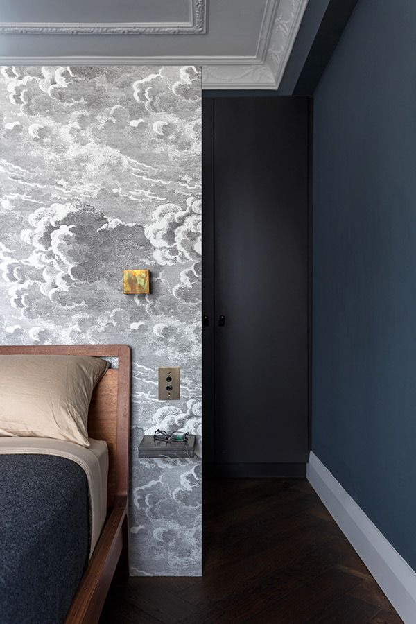 cloud wallpaper with the black walls and gold detailing