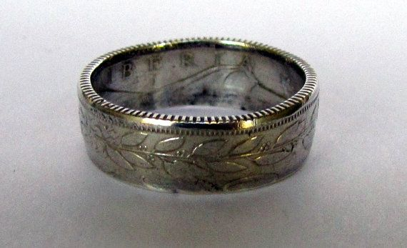 Welcome!    These coin rings are beautifully handcrafted and hand polished 90% Silver 1961 25 Cent Liberia coin rings in sizes 6-12. These rings
