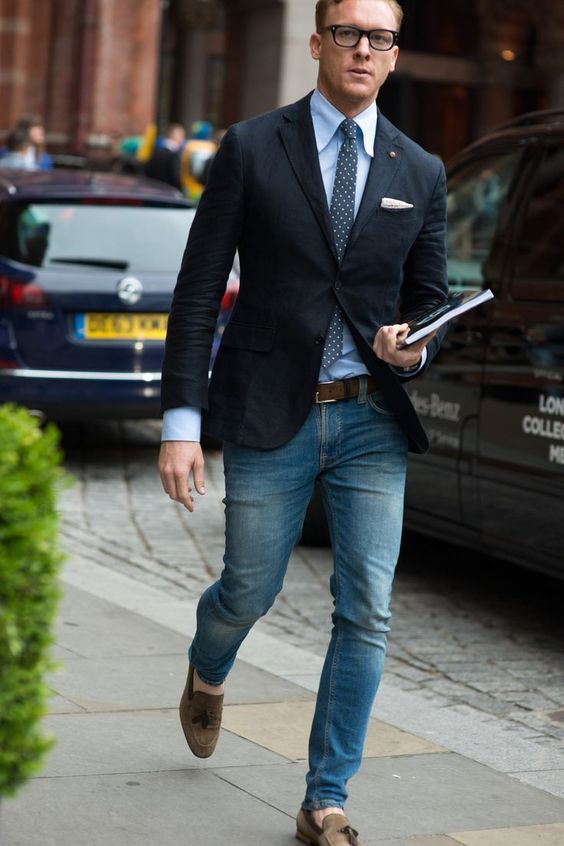 blue jeans, a polka dot tie and a black jacket