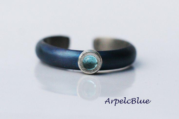 Blue titanium ring, titanium band with blue topaz from Arpelc Blue Titanium Jewelry by DaWanda.com