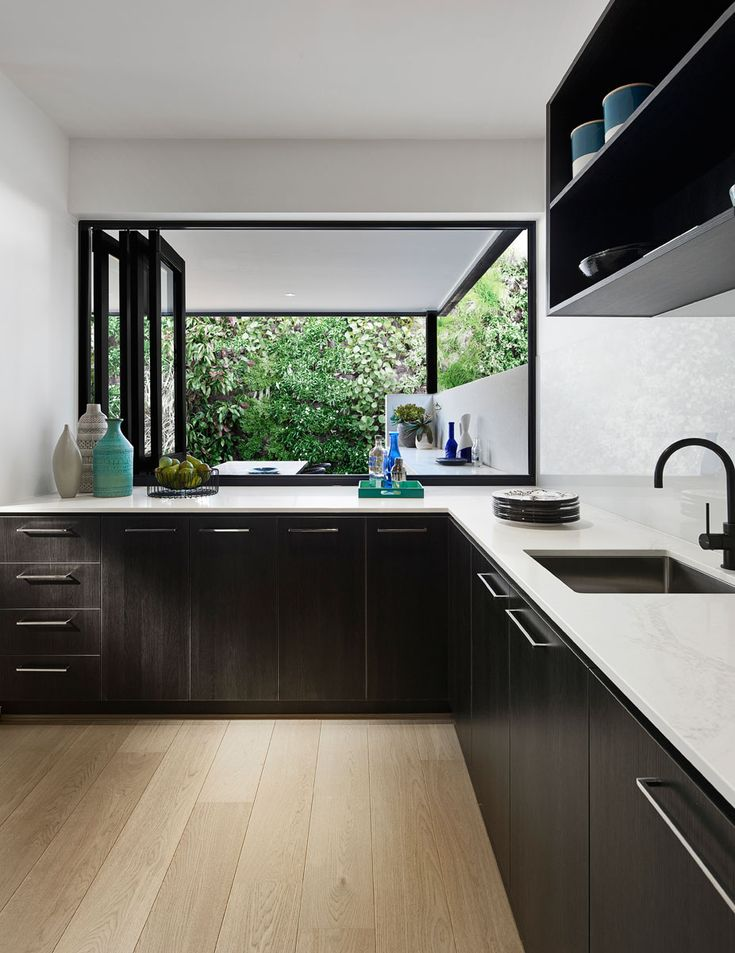 Arden Homes Kitchen featuring polytec Black Wenge RAVINE doors and Calacatta Nuvo benchtop surfaces.