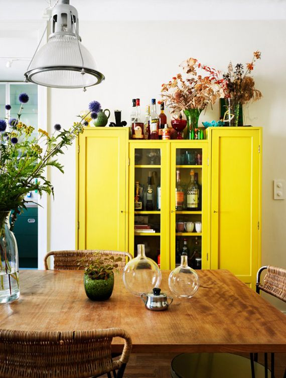 Bright yellow cabinet in the dining room