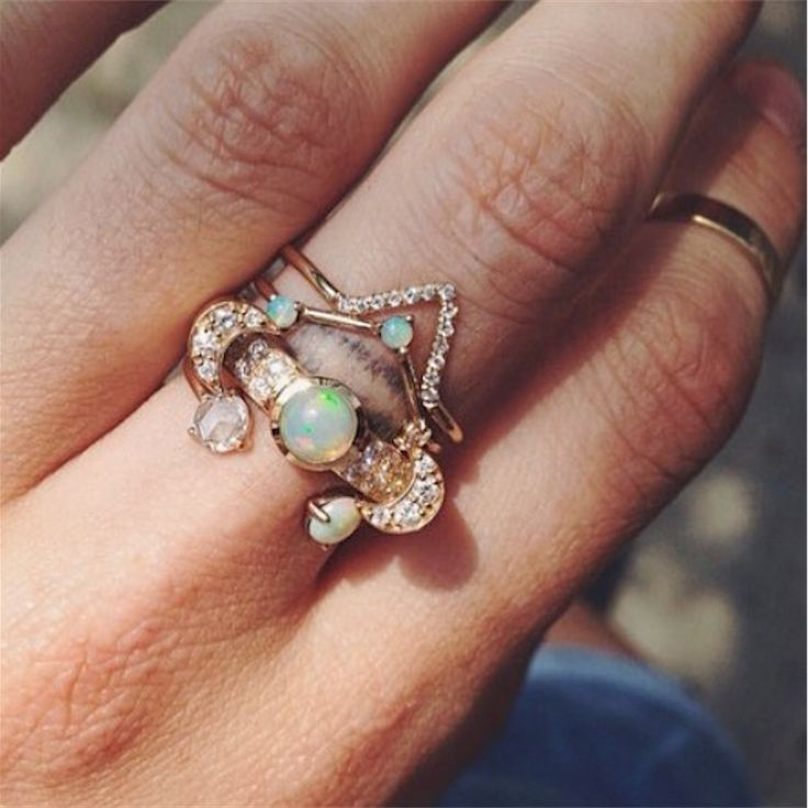CATBIRD Pavé Triangle, Three Step Triangle, Luna by PAMELA LOVE, and Open Opal & Rose Cut Diamond rings (Instagram: @honeyscout via @catbirdnyc)