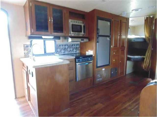 2016 New Forest River VIBE T272BHS Travel Trailer in California CA.Recreational Vehicle, rv, 2016 Forest River VIBE T272BHS, Call us for the absolute lowest price on this trailer!! We will not be undersold!!Complete PDI walk through as well as 24 hour technical support for as long as you own your trailer!!Options Include:E-Z lube axles,self adjusting brakes,one touch electric awning,full extention ball bearing drawer guides,stainless steel kitchen package,pot & pan drawers under dinette…