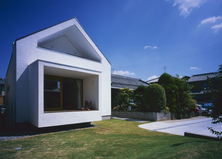 Geoemtric shapes puncture facade of House in Fukai by Naoko Horibe