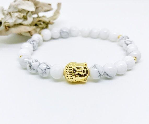 This Wrist Beaded Mala Bracelet is hand made with white Howlite 6mm beads and Gold plated accents. Keep this Buddha Bracelet for your self or give it as a Christmas Gift, Valentines day gift, Birthday Gift, Anniversary gift or any other special occasion.  GEMSTONE DESCRIPTION  The White Howlite is the stone of memory, knowledge and progress and is believed to eliminate pain, stress and anger. I sage all the Malas to cleanse the energy before shipping them out.  SIZING INFO  When selecting a…
