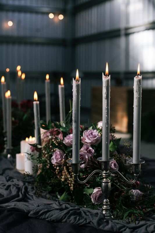 Styling @nomadstyling Photography @elkandwillow Moody candles at wedding with pink and burgundy florals- candlelight- dripping candles